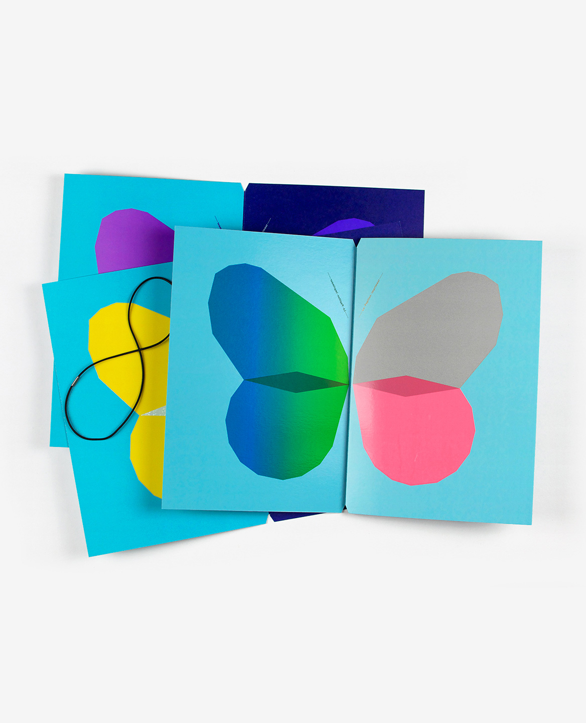 Violet, yellow, blue, green and pink butterflies from the book Le Papillon imprimeur