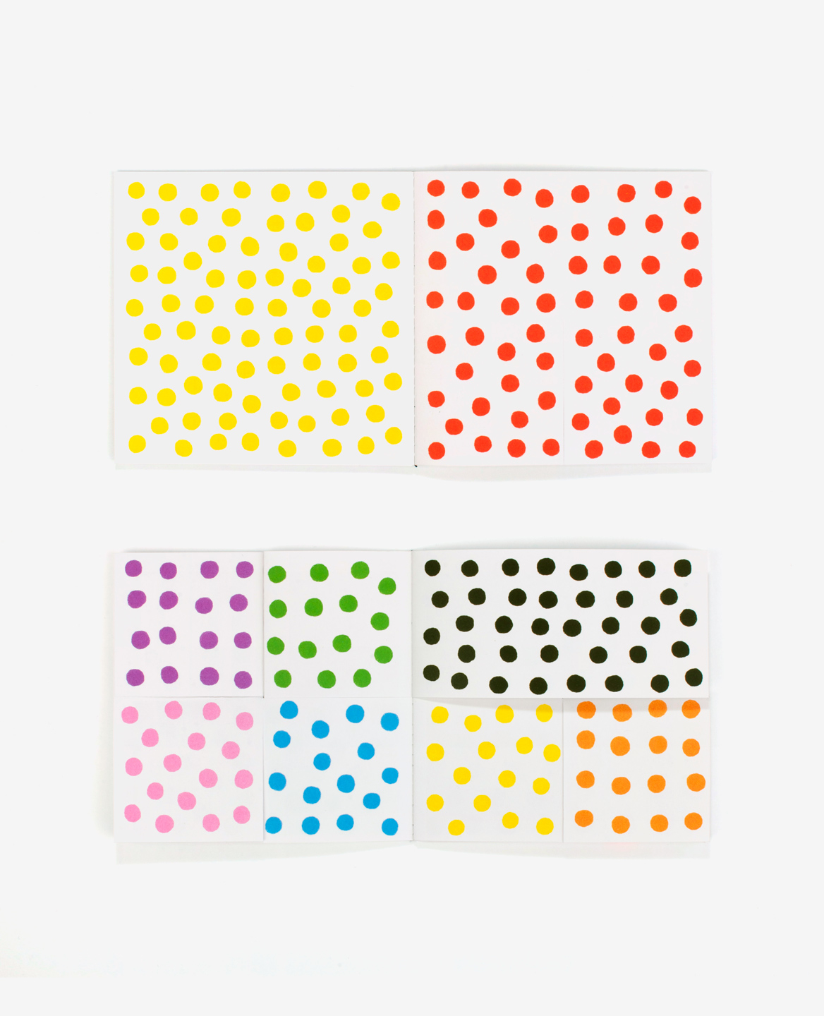 Multi colored pages of the book Dots by Antonio Ladrillo published by Éditions du livre
