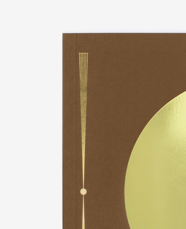 Détail de la dorure en couverture du livre Au soleil de Fanette Mellier publié aux Éditions du livre